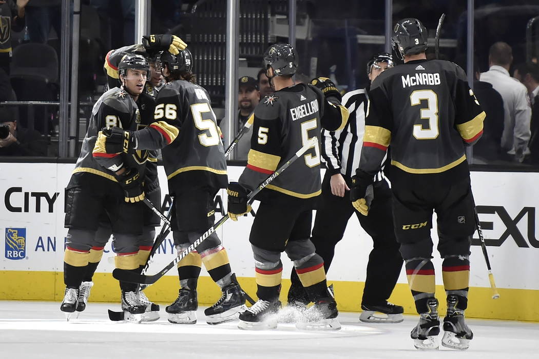Vegas Golden Knights center Jonathan Marchessault (81) celebrates with his team after scoring a goal on an empty net during the third period of an NHL hockey game Tuesday, Jan. 2, 2018, in Las Veg ...