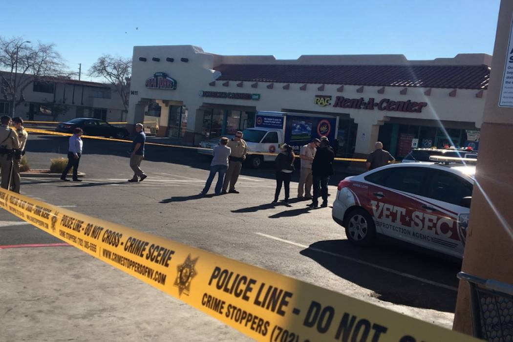 Las Vegas police investigate after a woman was shot in front of a checking cashing store near Jones and Vegas Drive on Thursday, January 11, 2018. (Bizuayehu Tesfaye/ Las Vegas Review-Journal)
