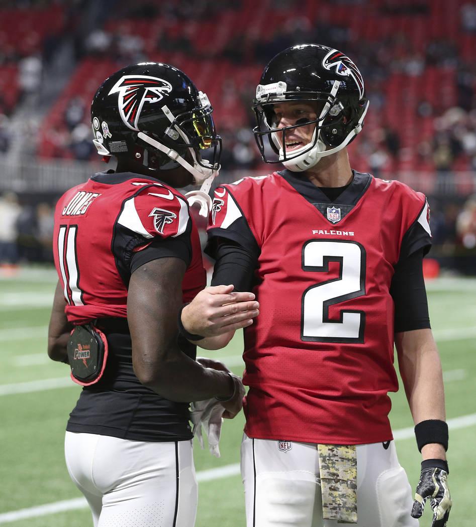 Atlanta Falcons quarterback Matt Ryan (2) speaks with Atlanta Falcons wide receiver Julio Jones (11) before the first half of an NFL football game between the Atlanta Falcons and the Dallas Cowboy ...