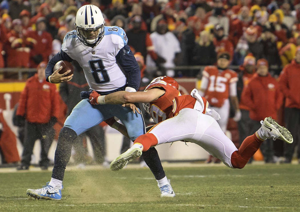 Tennessee Titans quarterback Marcus Mariota (8) is tackled by Kansas City Chiefs strong safety Daniel Sorensen (49) during a two-point attempt during the second half of an NFL wild-card playoff ga ...