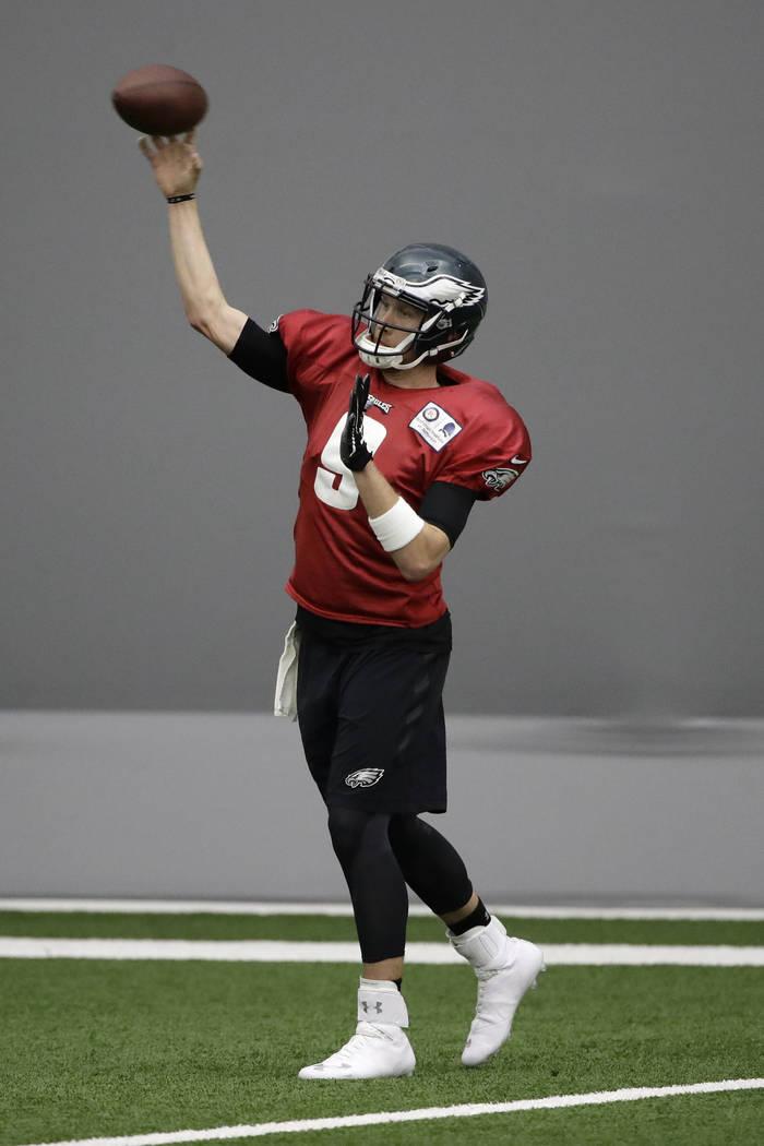 Philadelphia Eagles quarterback Nick Foles throws a pass during practice at the team's NFL football training facility in Philadelphia, Tuesday, Jan. 9, 2018. (AP Photo/Matt Rourke)