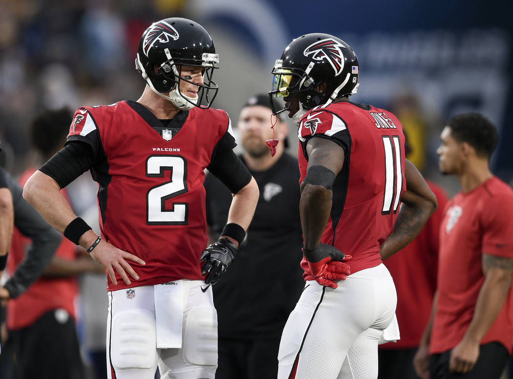 Atlanta Falcons quarterback Matt Ryan, left, talks with wide receiver Julio Jones before an NFL football wild-card playoff game against the Los Angeles Rams Saturday, Jan. 6, 2018, in Los Angeles. ...