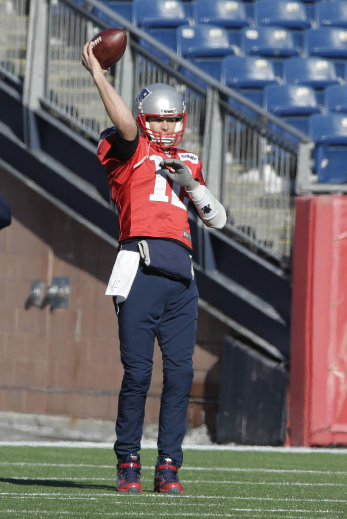 New England Patriots quarterback Tom Brady throws the ball while warming up during an NFL football practice, Wednesday, Jan. 10, 2018, at Gillette Stadium, in Foxborough, Mass. The Patriots are sc ...