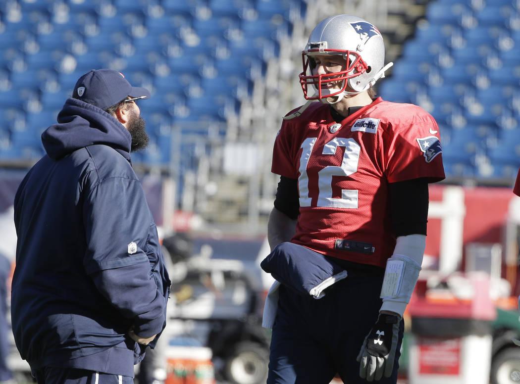 New England Patriots defensive coordinator Matt Patricia, left, and quarterback Tom Brady, right, speak during an NFL football practice, Wednesday, Jan. 10, 2018, at Gillette Stadium, in Foxboroug ...
