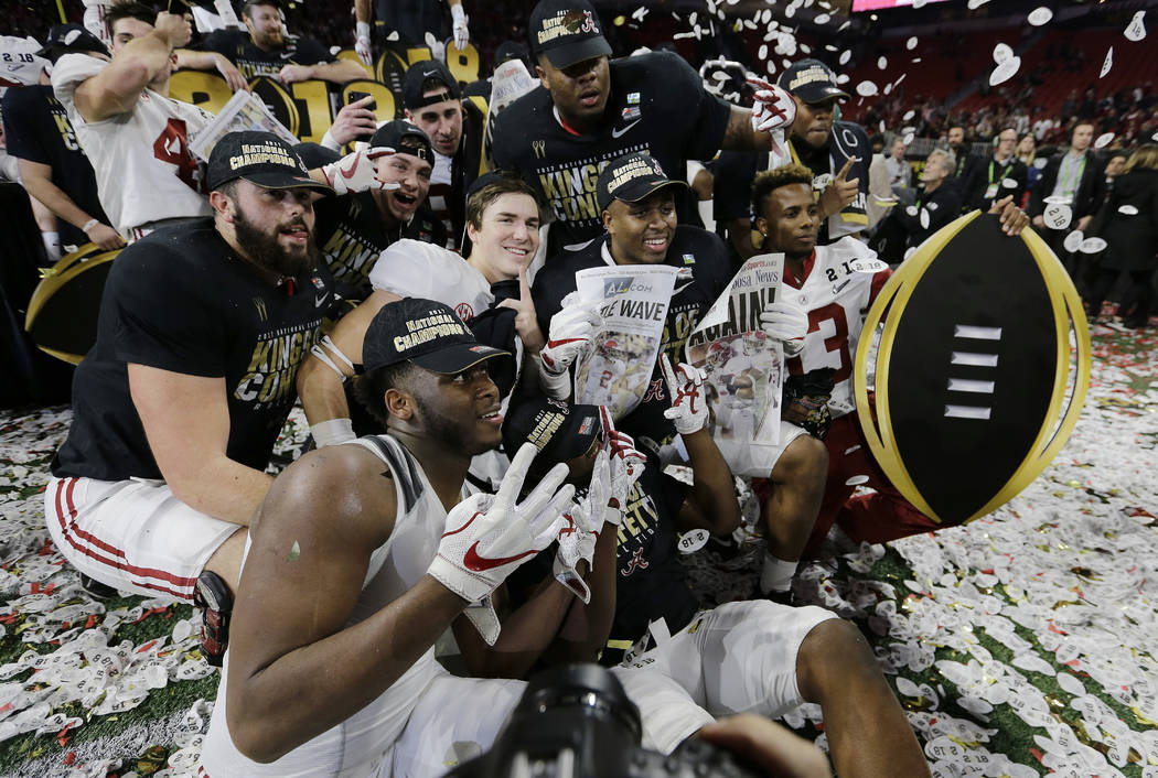 Alabama players celebrate after overtime of the NCAA college football playoff championship game against Georgia Monday, Jan. 8, 2018, in Atlanta. Alabama won 26-23. (AP Photo/David J. Phillip)