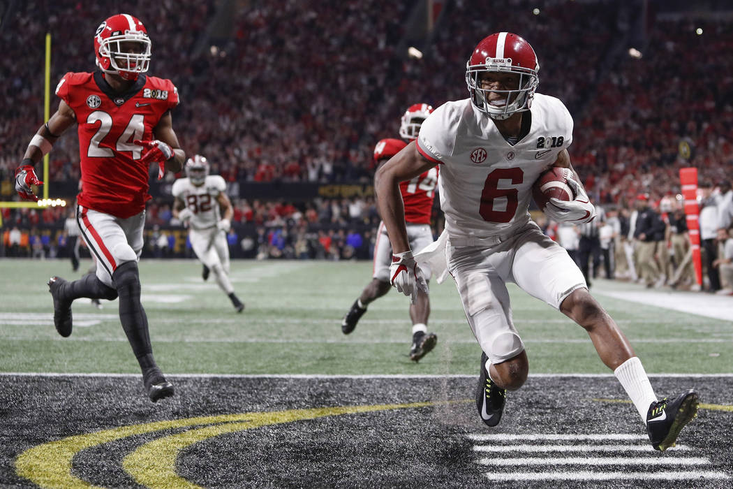 Alabama wide receiver DeVonta Smith (6) scores the game winning touchdown in overtime during the College Football Playoff National Championship game between Georgia and Alabama on Monday, Jan. 8,  ...
