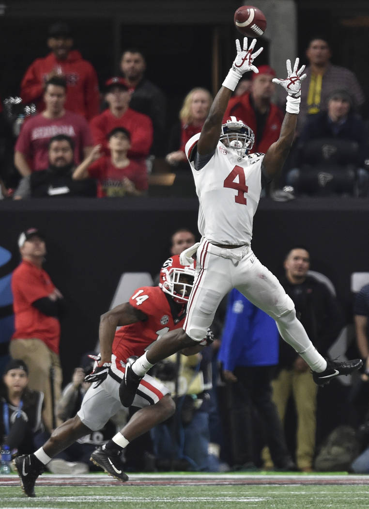 Alabama wide receiver Jerry Jeudy (4) jumps to catch a pass ahead of Georgia corner back Malkom Parrish (14) during the College Football Playoff National Championship game between Georgia and Alab ...