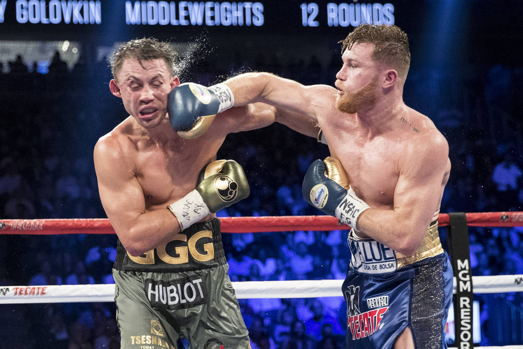 Saul Alvarez, right, connects a punch against Gennady Golovkin in the WBC, WBA, IBF, RING middleweight title bout at T-Mobile Arena in Las Vegas, Saturday, Sept. 16, 2017. The fight ended in a spl ...