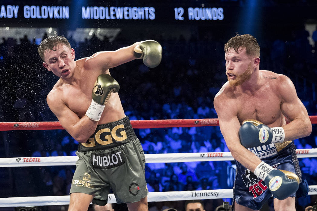 Saul Canelo Alvarez, right, after connecting a punch against Gennady GGG Golovkin in the WBC, WBA, IBF, RING middleweight title bout at T-Mobile Arena in Las Vegas, Saturday, Sept. 16, 2017. The f ...