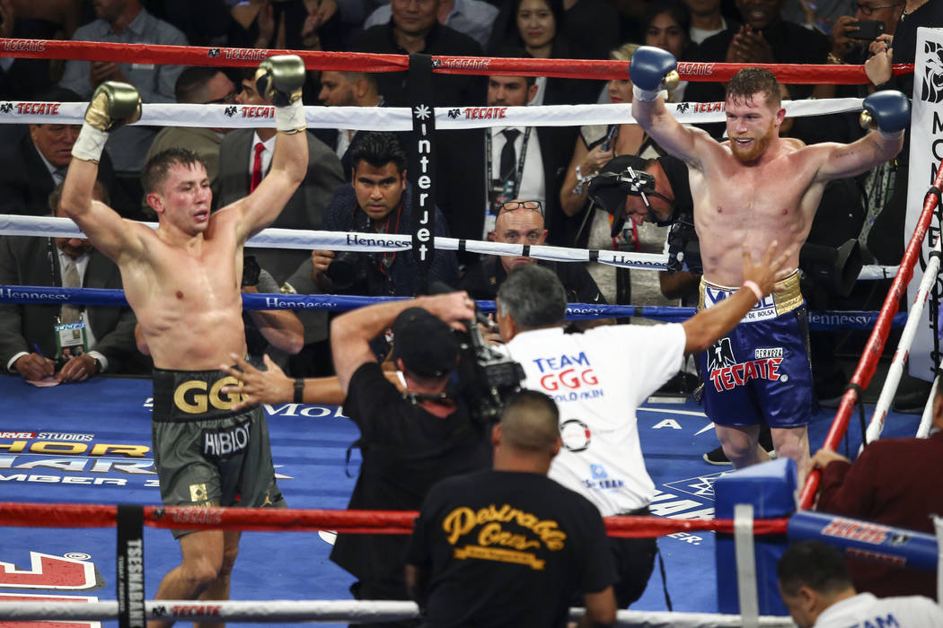 Saul Alvarez, left, and Gennady Golovkin at the end of their middleweight championship boxing match at T-Mobile Arena in Las Vegas on Saturday, Sept. 16, 2017. The fight ended in a draw. Chase Ste ...