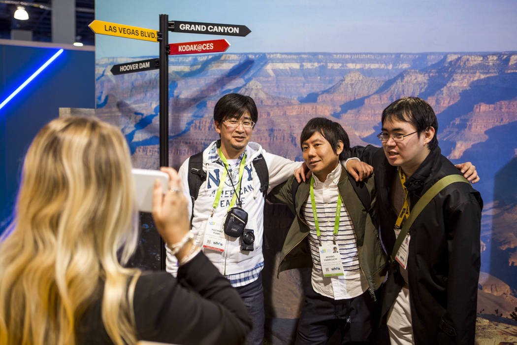 CES attendees have their photo taken against a Grand Canyon backdrop with a Kodak Mini Shot instant camera at CES in the Las Vegas Convention Center on Thursday, Jan. 11, 2018. Patrick Connolly La ...