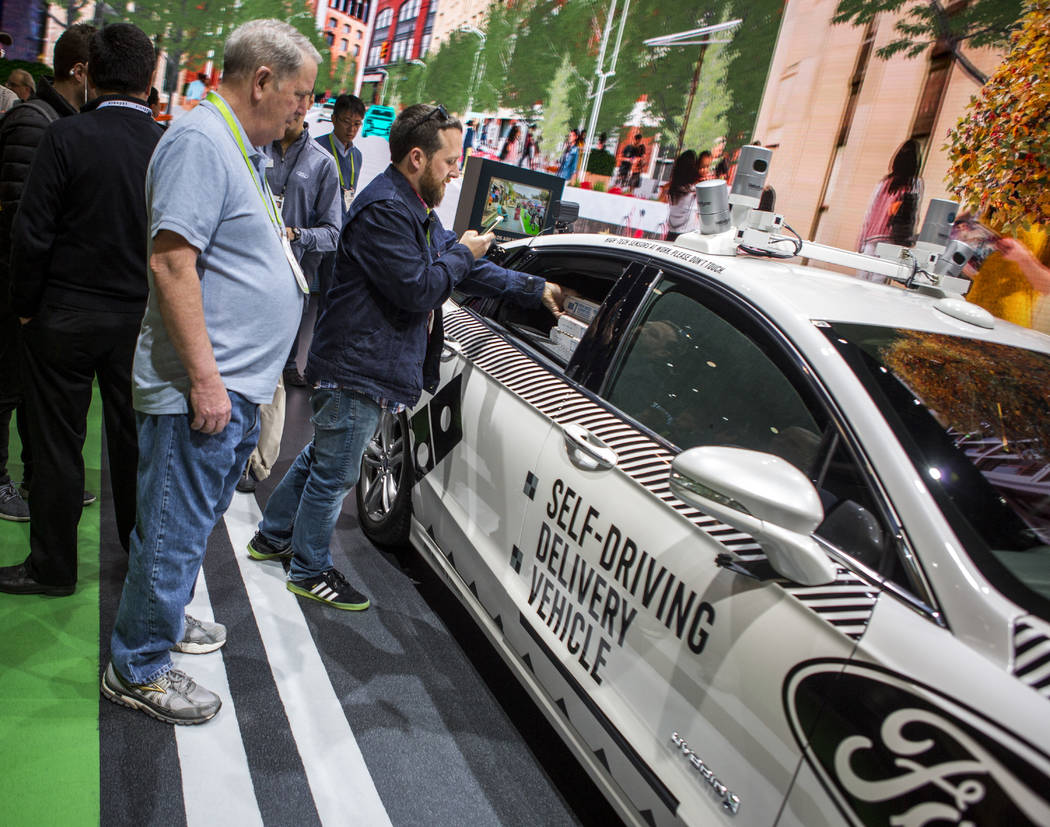 CES attendees check out a Ford self-driving delivery vehicle at CES in the Las Vegas Convention Center on Thursday, Jan. 11, 2018. Patrick Connolly Las Vegas Review-Journal @PConnPie