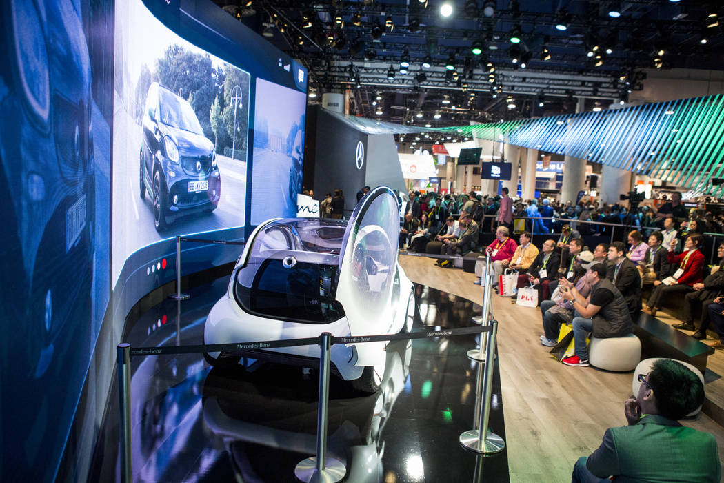 CES attendees view a video on a new Smart Car electric vehicle at CES in the Las Vegas Convention Center on Thursday, Jan. 11, 2018. Patrick Connolly Las Vegas Review-Journal @PConnPie