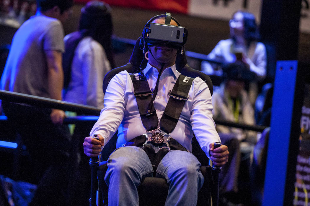 A CES attendee tests a Samsung VR experience at CES in the Las Vegas Convention Center on Thursday, Jan. 11, 2018. Patrick Connolly Las Vegas Review-Journal @PConnPie