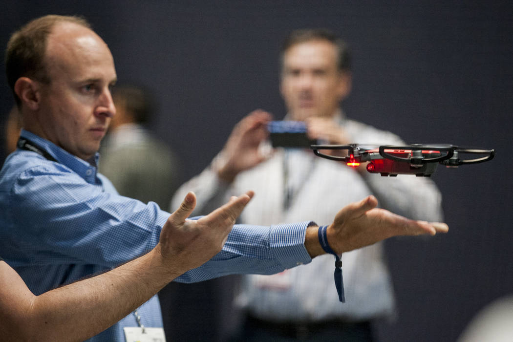 Gregg Barker tries out a DJI drone at CES in the Las Vegas Convention Center on Thursday, Jan. 11, 2018. Patrick Connolly Las Vegas Review-Journal @PConnPie