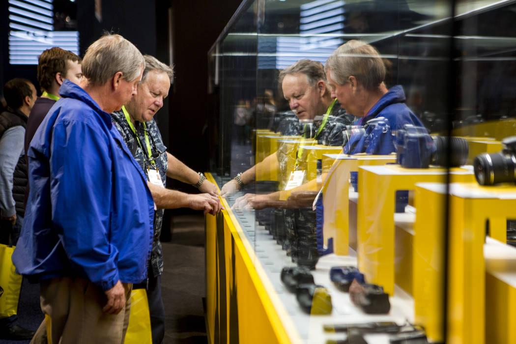 CES attendees browse Nikon lenses at CES in the Las Vegas Convention Center on Thursday, Jan. 11, 2018. Patrick Connolly Las Vegas Review-Journal @PConnPie