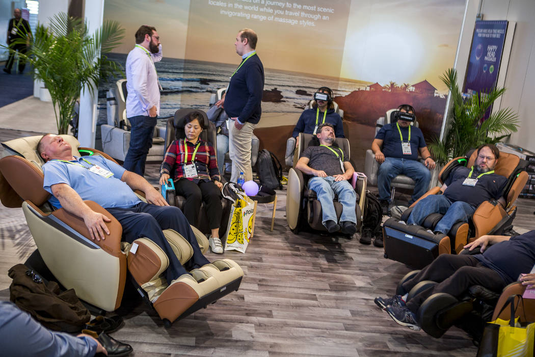 CES attendees try massage chairs from Homedics at CES in the Las Vegas Convention Center on Thursday, Jan. 11, 2018. Patrick Connolly Las Vegas Review-Journal @PConnPie