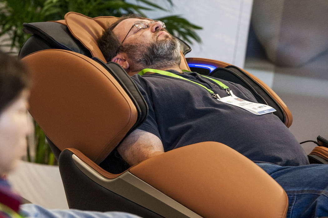 Steven Smallwood tries a Homedics massage chair at CES in the Las Vegas Convention Center on Thursday, Jan. 11, 2018. Patrick Connolly Las Vegas Review-Journal @PConnPie