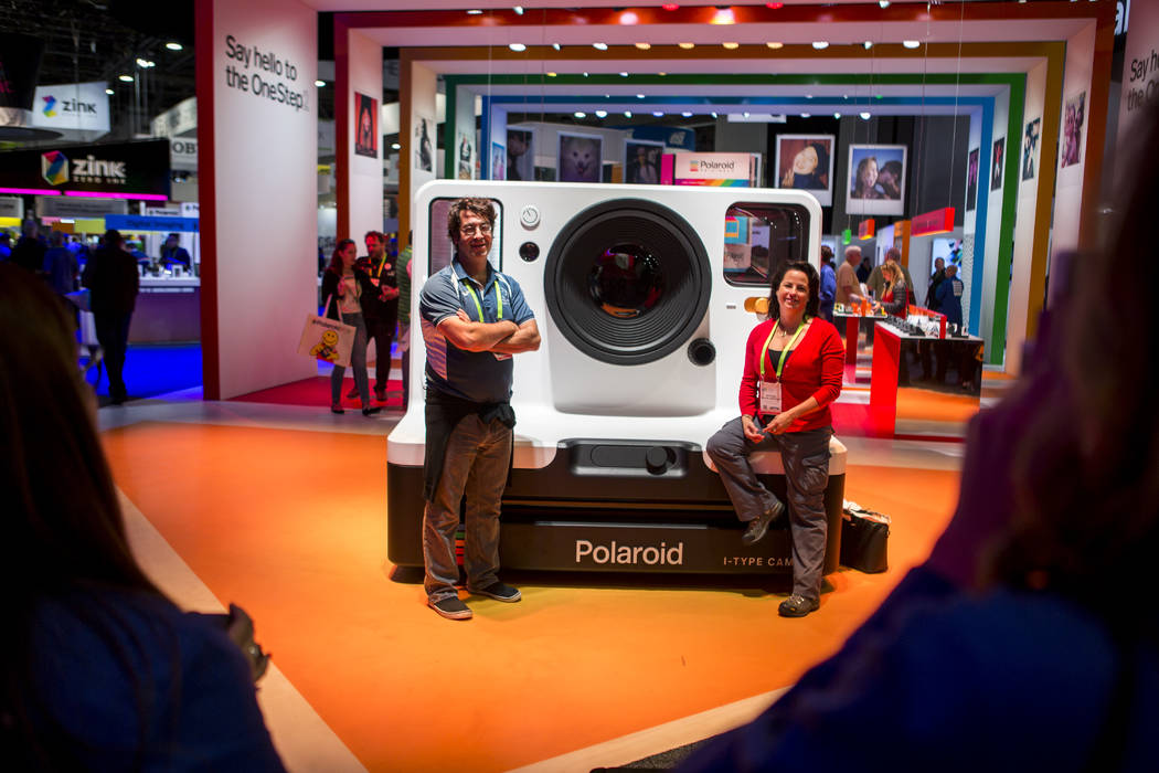 CES attendees have Polaroid instant photos taken of them near a large Polaroid camera at CES in the Las Vegas Convention Center on Thursday, Jan. 11, 2018. Patrick Connolly Las Vegas Review-Journa ...