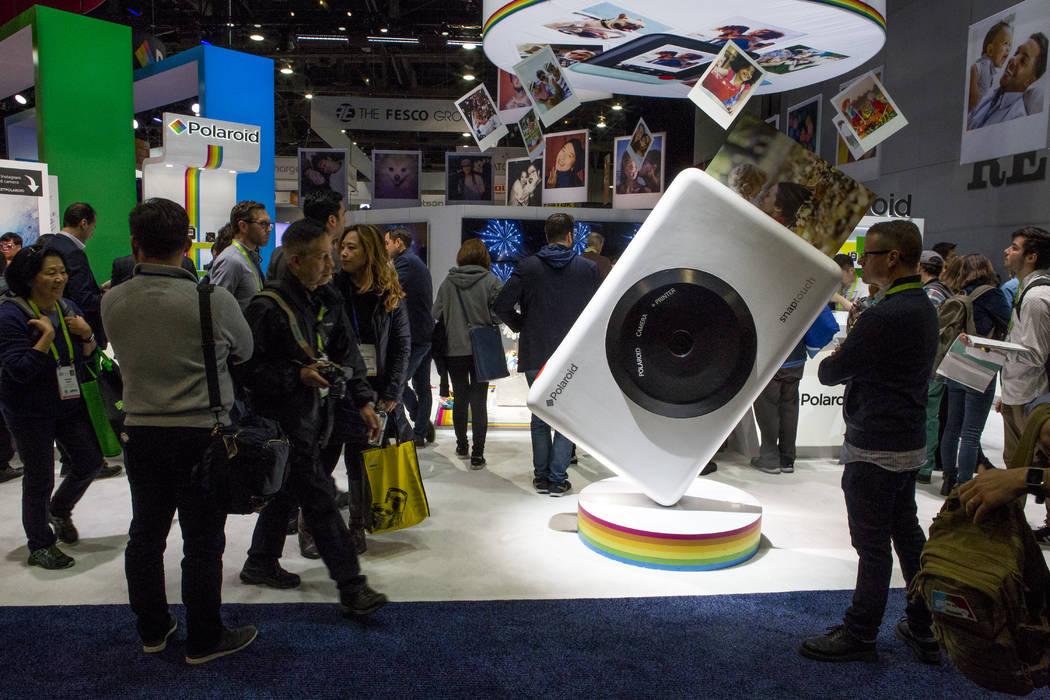 CES attendees walk around the Polaroid exhibit at CES in the Las Vegas Convention Center on Thursday, Jan. 11, 2018. Patrick Connolly Las Vegas Review-Journal @PConnPie