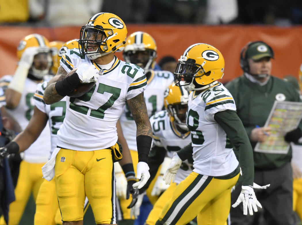 Green Bay Packers strong safety Josh Jones (27) celebrates his interception in overtime during an NFL football game against the Cleveland Browns, Sunday, Dec. 10, 2017, in Cleveland. The Packers w ...