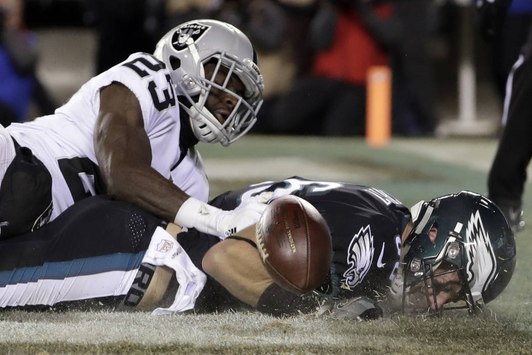 Philadelphia Eagles' Zach Ertz, right, cannot catch a pass in the end zone against Oakland Raiders' Dexter McDonald during the first half of an NFL football game, Monday, Dec. 25, 2017, in Philade ...