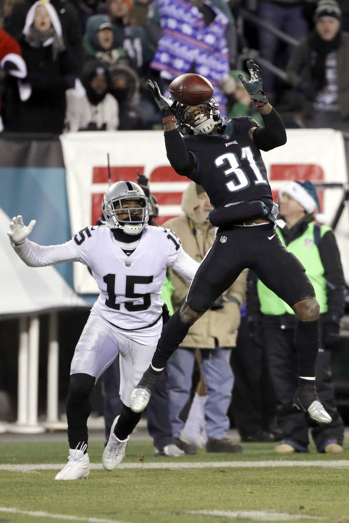 Philadelphia Eagles' Jalen Mills (31) breaks up a pass intended for Oakland Raiders' Michael Crabtree (15) during the second half of an NFL football game, Monday, Dec. 25, 2017, in Philadelphia. ( ...