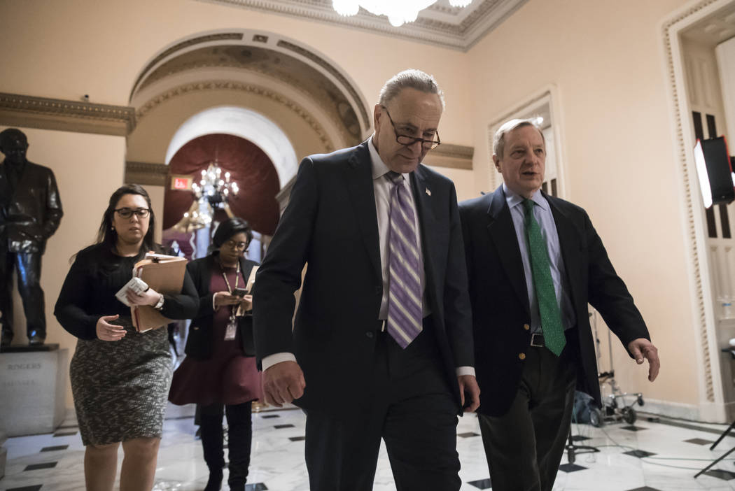 Senate Minority Leader Chuck Schumer, D-N.Y., left, walks with Sen. Dick Durbin, D-Ill., the minority whip, as lawmakers continue negotiating on a deal that would include a fix for the Deferred Ac ...