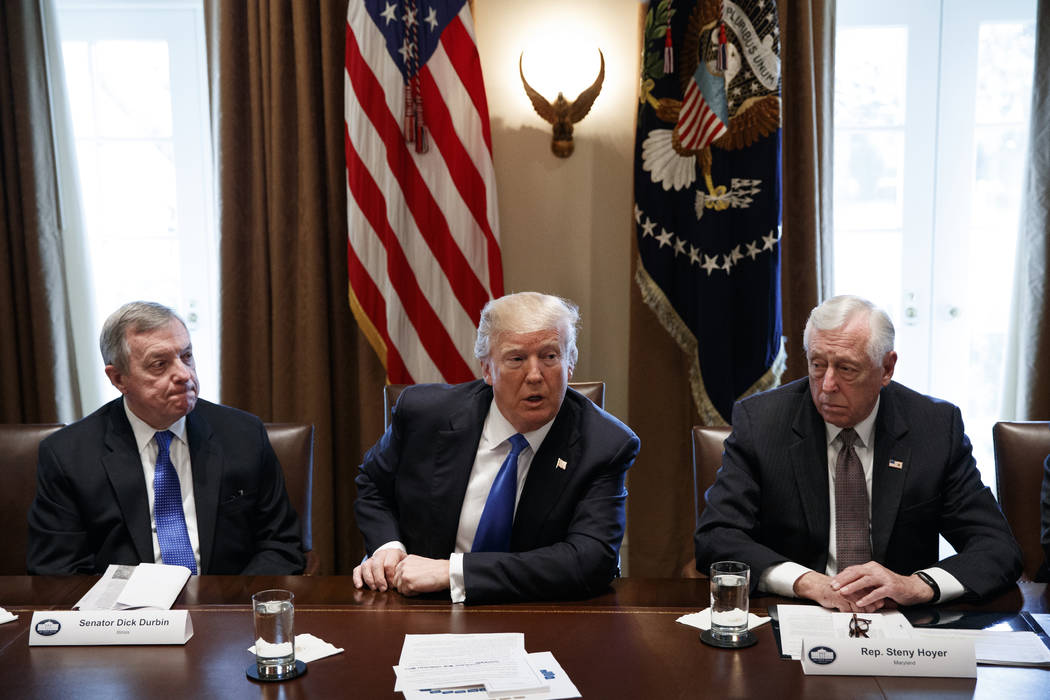 Sen. Dick Durbin, D-Ill., left, and Rep. Steny Hoyer, D-Md. listen as President Donald Trump speaks during a meeting with lawmakers on immigration policy in the Cabinet Room of the White House in  ...