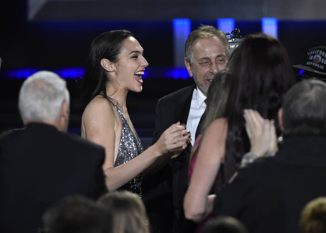 "Gal Gadot reacts in the audience as ""Wonder Woman"" wins for best action movie at the 23rd annual Critics' Choice Awards at the Barker Hangar on Thursday, Jan. 11, 2018, in Santa  ..."