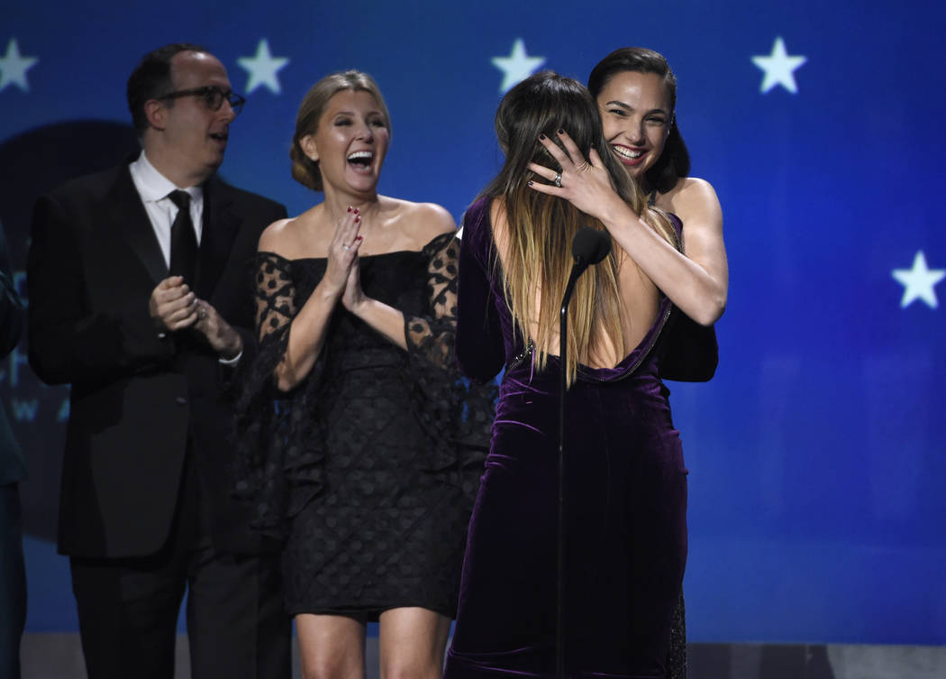 "Gal Gadot and Patty Jenkins embrace as ""Wonder Woman"" wins the award for best action movie at the 23rd annual Critics' Choice Awards at the Barker Hangar on Thursday, Jan. 11, 20 ..."