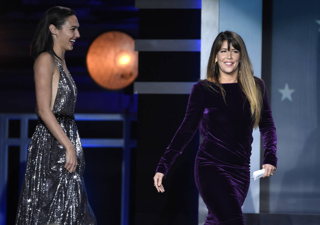 "Gal Gadot, left, and Patty Jenkins walk on stage to accept the award for best action movie for ""Wonder Woman"" at the 23rd annual Critics' Choice Awards at the Barker Hangar on Th ..."