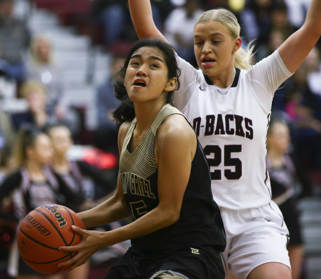 Spring Valley's Chelsea Camara (5) looks to shoot as Desert Oasis' Melissa Simmons (25) defends during a basketball game at Desert Oasis High School in Las Vegas on Tuesday, Jan. 16, 2018. Chase S ...