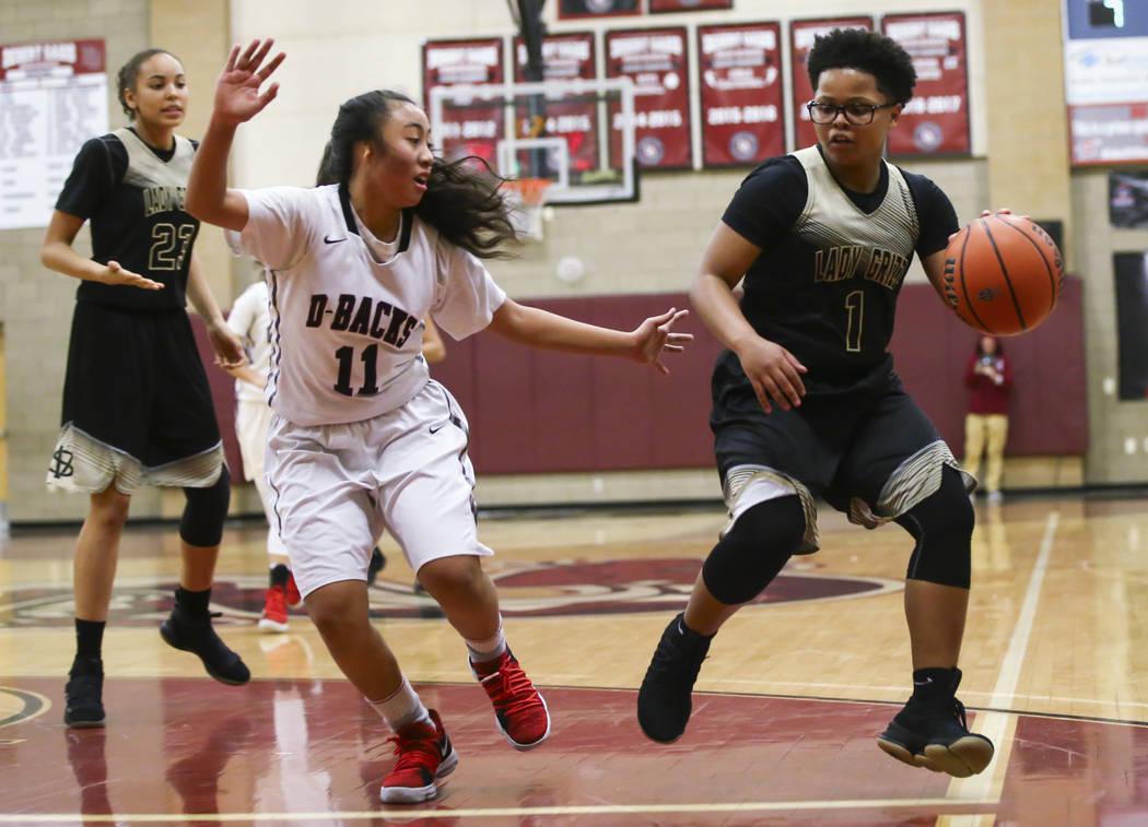 Spring Valley's Deja McDonald (1) drives against Desert Oasis' Kalena Halunajan (11) during a basketball game at Desert Oasis High School in Las Vegas on Tuesday, Jan. 16, 2018. Chase Stevens Las  ...