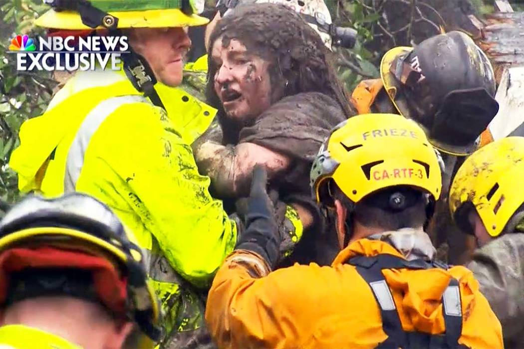 This frame from video provided by NBC News shows the rescue of a 14-year-old girl from the wreckage of a home after heavy rains trapped dozens of people in Montecito, Calif., Tuesday, Jan. 9, 2018 ...