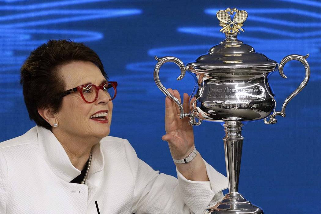 Billie Jean King, former ladies singles champion holds the Daphne Akhurst Memorial Cup during a press conference ahead of the Australian Open tennis championships in Melbourne, Australia Friday, J ...