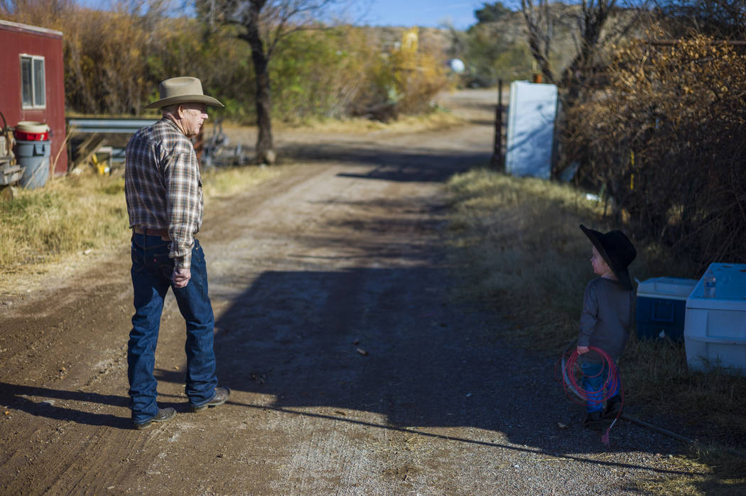 Cliven Bundy walks with his grandson Roper at Bundy Ranch in Bunkerville on Thursday, Jan. 11, 2018. Bundy was released from federal custody after charges against him were dismissed in his trial.  ...