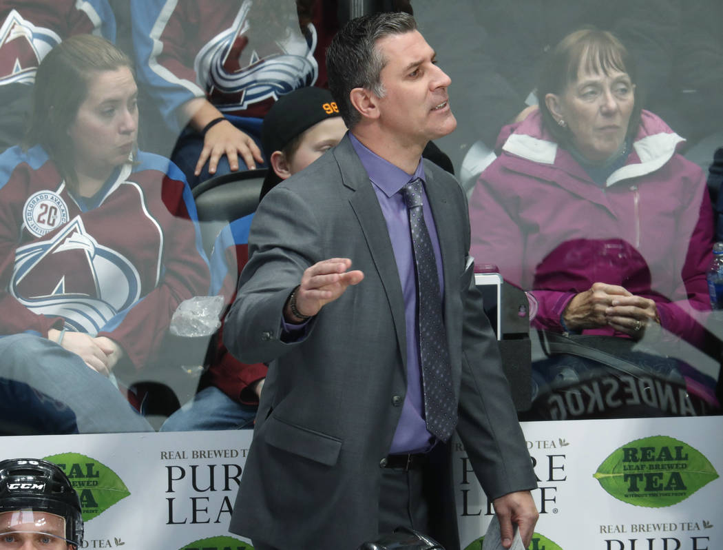 Colorado Avalanche coach Jared Bednar stands behind the bench during the third period of the team's NHL hockey game against the Arizona Coyotes on Wednesday, Dec. 27, 2017, in Denver. The Coyotes  ...