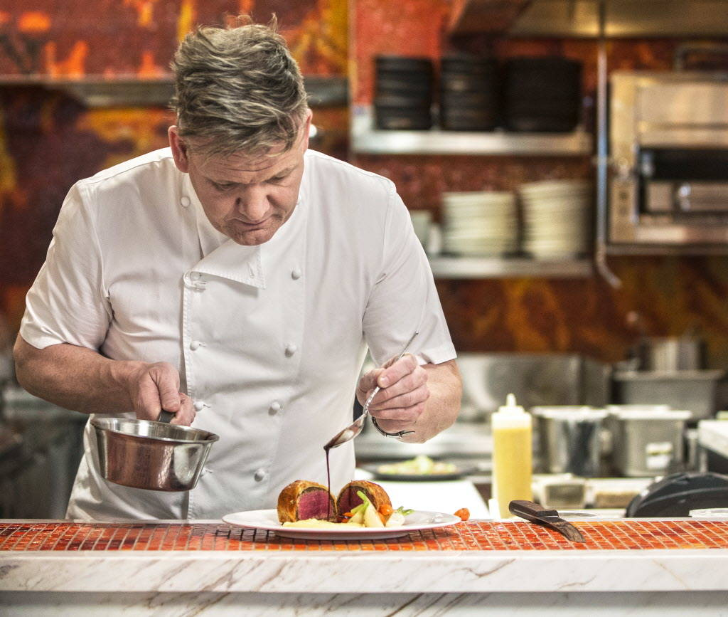 Celebrity chef Gordon Ramsay prepares beef wellington at his new Strip restaurant Hell's Kitchen on Sunday, January 7, 2018, at Caesars Palace hotel-casino, in Las Vegas. Benjamin Hager Las Vegas  ...