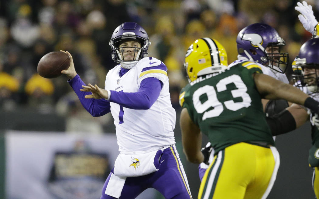 Minnesota Vikings' Case Keenum throws during the first half of an NFL football game against the Green Bay Packers Saturday, Dec. 23, 2017, in Green Bay, Wis. (AP Photo/Jeffrey Phelps)