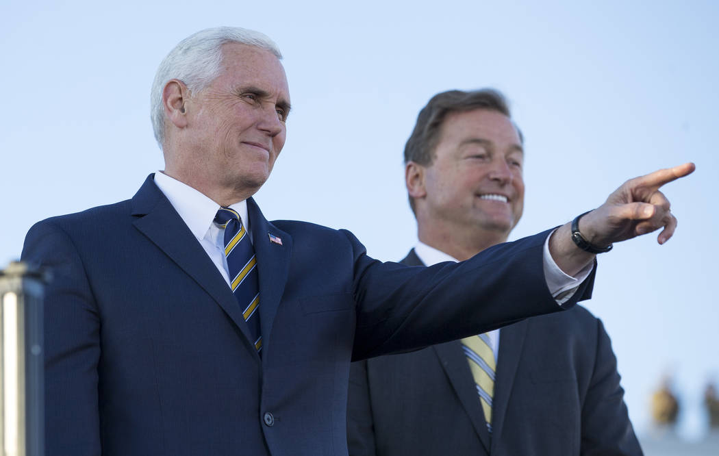 United States Vice President Mike Pence, left, and Nevada Senator Dean Heller acknowledge the crowd before speaking to airmen during visit to Nellis Air Force Base near Las Vegas, Nevada on Thursd ...