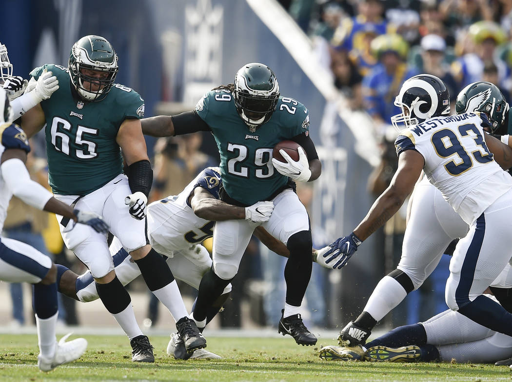Philadelphia Eagles running back LeGarrette Blount center, runs the ball during the first half of an NFL football game against the Los Angeles Rams Sunday, Dec. 10, 2017, in Los Angeles. (AP Photo ...