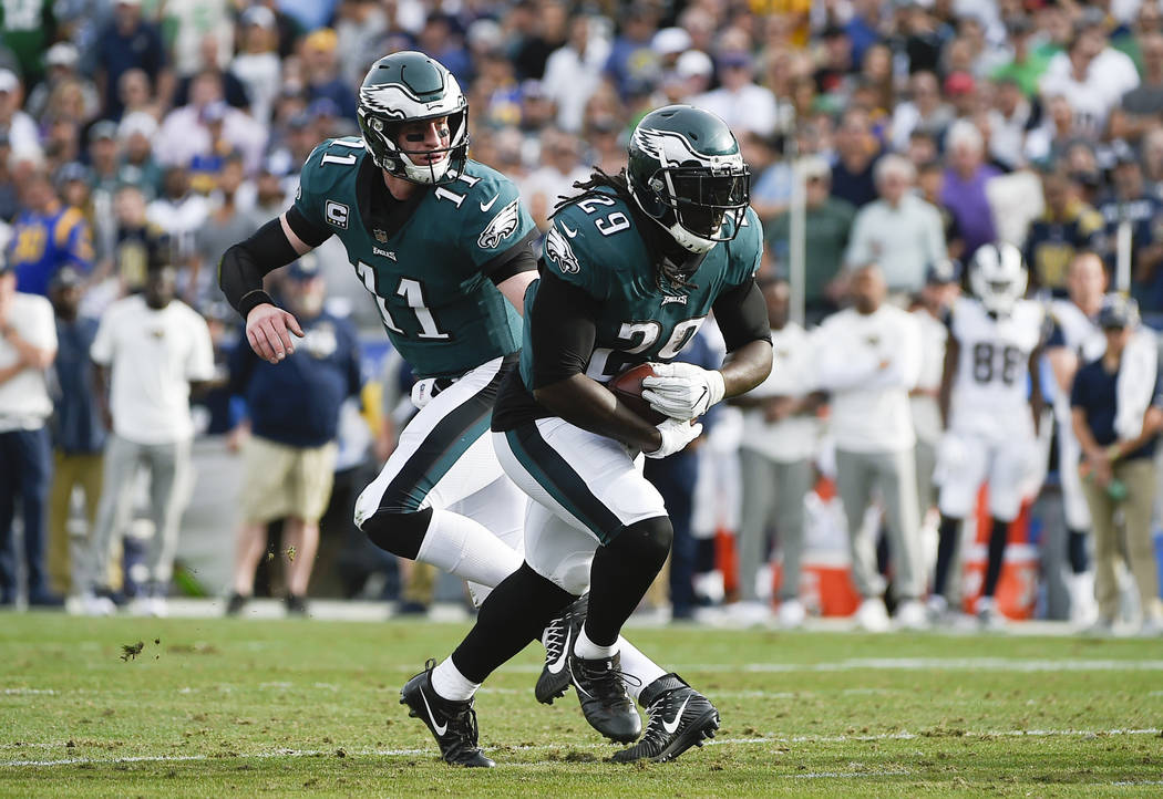 Philadelphia Eagles running back LeGarrette Blount, right, runs the ball during the first half of an NFL football game against the Los Angeles Rams Sunday, Dec. 10, 2017, in Los Angeles. (AP Photo ...