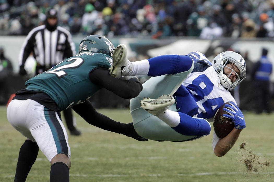 Dallas Cowboys' James Hanna (84) is tackled by Philadelphia Eagles' Rasul Douglas (32) during the second half of an NFL football game, Sunday, Dec. 31, 2017, in Philadelphia. (AP Photo/Chris Szagola)