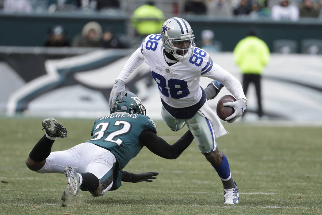 Dallas Cowboys' Dez Bryant, right, is tackled by Philadelphia Eagles' Rasul Douglas during the second half of an NFL football game, Sunday, Dec. 31, 2017, in Philadelphia. (AP Photo/Chris Szagola)