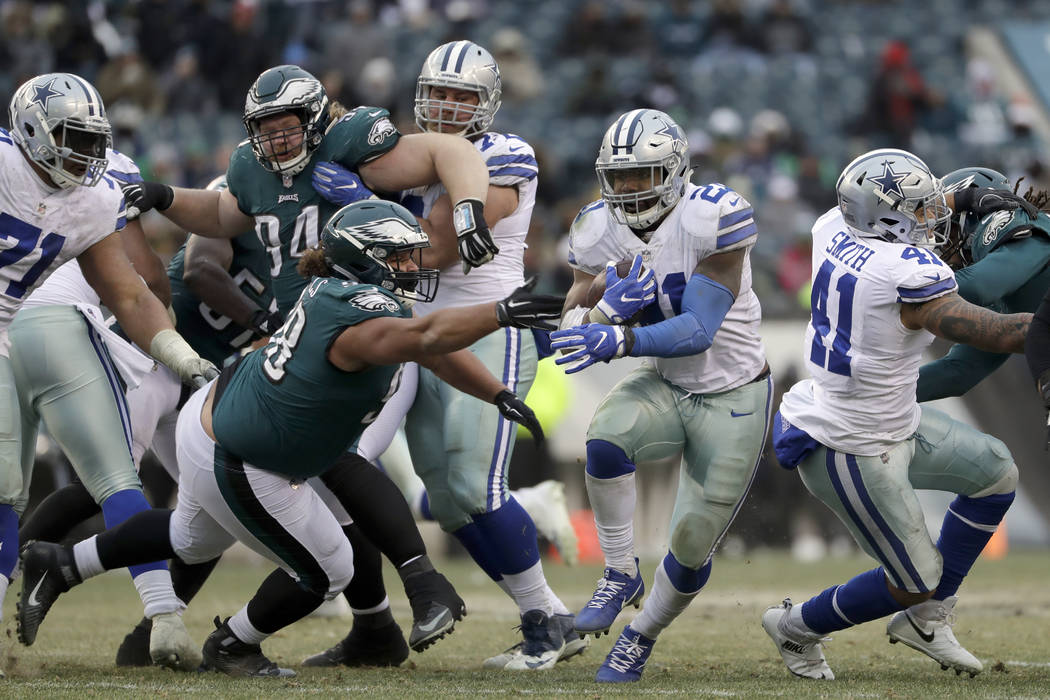 Dallas Cowboys' Ezekiel Elliott in action during the second half of an NFL football game against the against the Philadelphia Eagles, Sunday, Dec. 31, 2017, in Philadelphia. (AP Photo/Michael Perez)