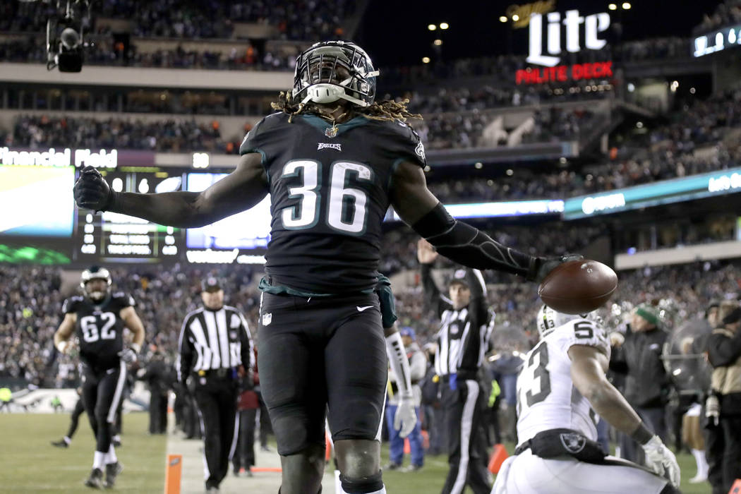 FILE - In this Dec. 25, 2017, file photo, Philadelphia Eagles' Jay Ajayi reacts after scoring a touchdown during the first half of an NFL football game against the Oakland Raiders,in Philadelphia. ...