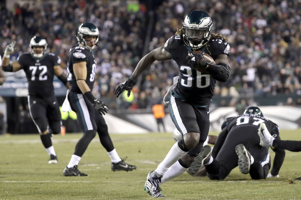 FILE - In this Dec. 25, 2017, file photo, Philadelphia Eagles' Jay Ajayi (36) runs for a touchdown during the first half of an NFL football game against the Oakland Raiders, in Philadelphia.  The  ...