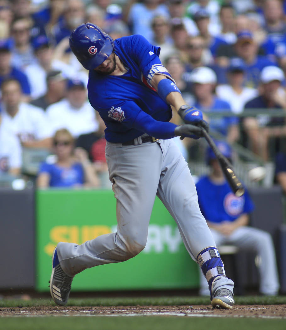 In this Sept. 24, 2017, file photo, Chicago Cubs third baseman Kris Bryant hits an RBI-double against the Milwaukee Brewers during the fourth inning of an baseball game in Milwaukee. The hot corne ...