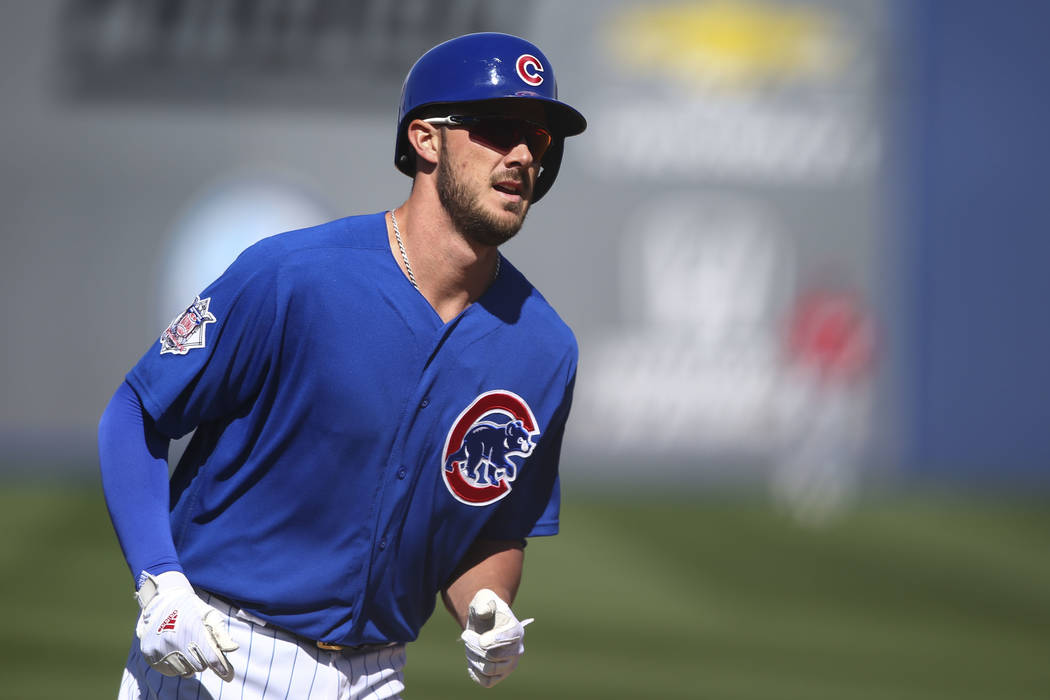 Chicago Cubs third baseman Kris Bryant (17) rounds the bases after hitting a home run against Cincinnati during their Big League Weekend baseball game at Cashman Field in Las Vegas on Saturday, Ma ...